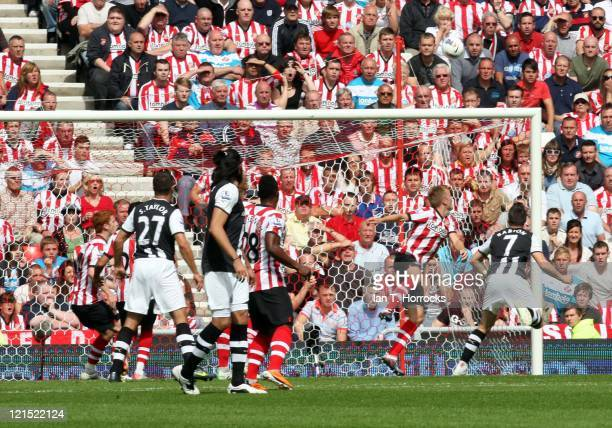 Joey Barton of Newcastle sees his headed effort stopped by Seb Larrson during the Barclays Premier League match between Sunderland and Newcastle...