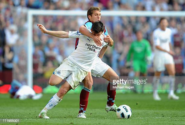 Joey Barton of Newcastle United and Stiliyan Petrov of Aston Villa battle for the ball during the Barclays Premier League match between Aston Villa...