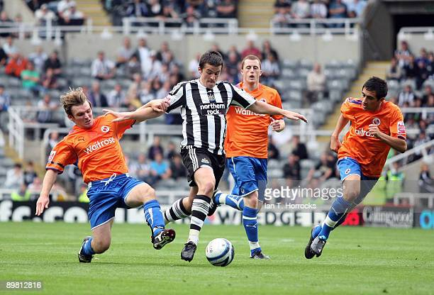 Joey Barton of Newcastle United battles for the ball during the CocaCola Championship match between Newcastle United and Reading at St James' Park on...