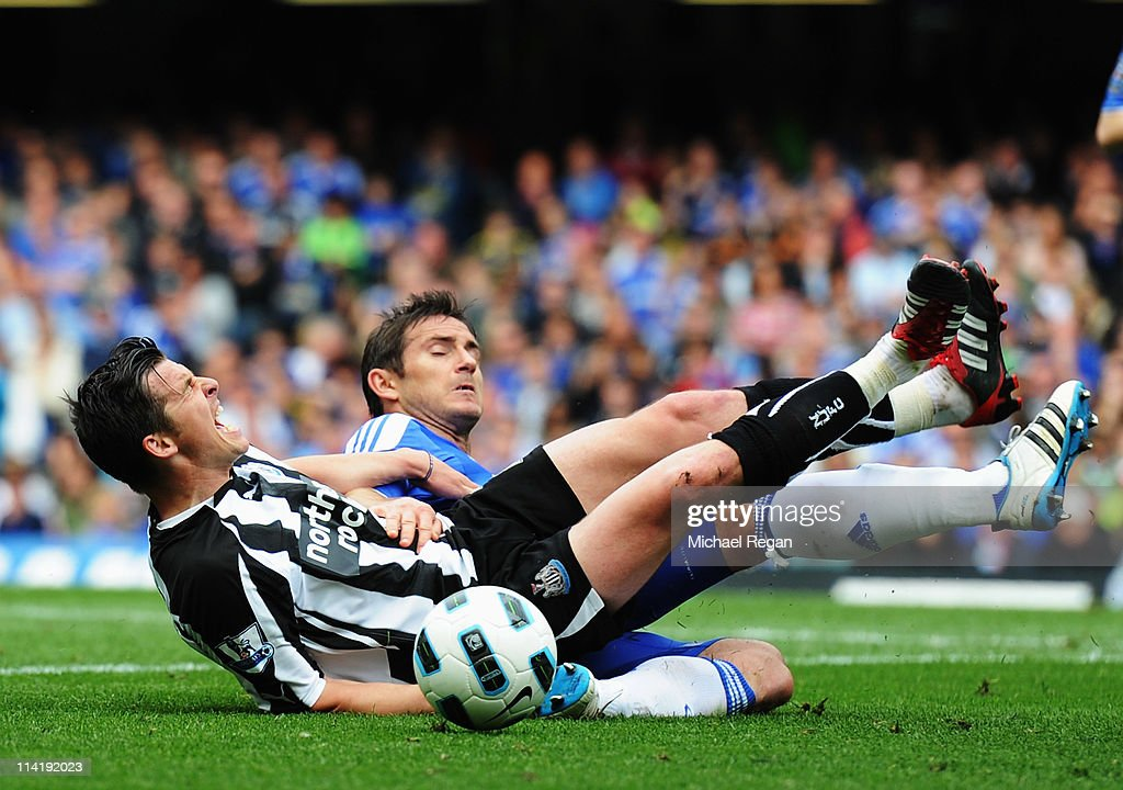 Joey Barton (front) of Newcastle United is fouled by Frank Lampard of Chelsea during the Barclays Premier League match between Chelsea and Newcastle United at Stamford Bridge on May 15, 2011 in London, England.