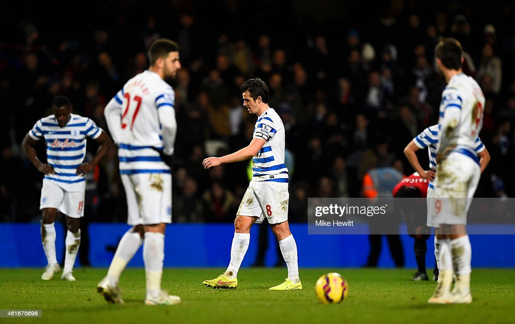 Joey Barton of QPR and his team-mates show their dejection after conceding a goal during the Barclays Premier League match between Queens Park Rangers and Manchester United at Loftus Road on January 17, 2015 in London, England.