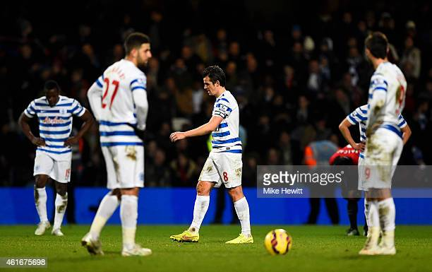 Joey Barton of QPR and his team-mates show their dejection after conceding a goal during the Barclays Premier League match between Queens Park...