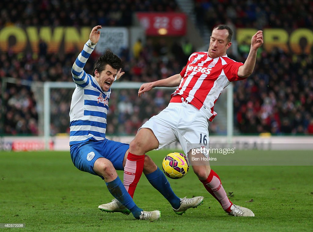Joey Barton of QPR is tackled by Charlie Adam of Stoke City during the Barclays Premier League match between Stoke City and Queens Park Rangers at Britannia Stadium on January 31, 2015 in Stoke on Trent, England.