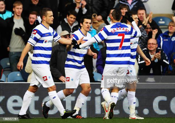 Joey Barton of Queens Park Rangers is congratulated by team mate after scoring during the Barclays Premier League match between Queens Park Rangers...