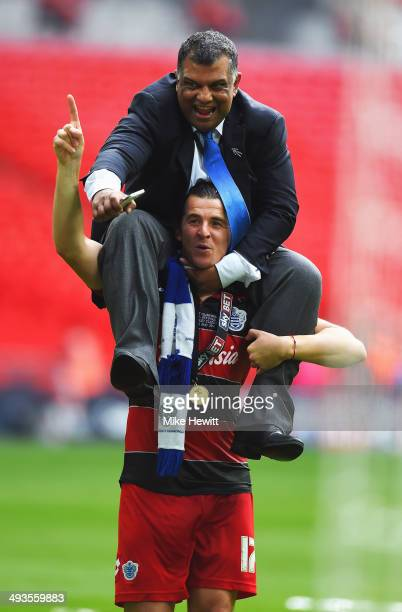 Joey Barton of Queens Park Rangers lifts Queens Park Rangers Chairman Tony Fernandes onto his shoulders following their victory during the Sky Bet...
