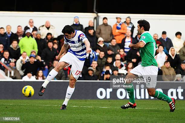 Joey Barton of Queens Park Rangers shoots to score the opening goal during the Barclays Premier League match between Queens Park Rangers and Norwich...