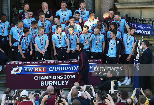Joey Barton reacts in front of team mates as he is not presented with a medal as Sky Bet Champions Burnley are presented with the Championship trophy...