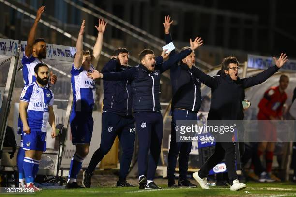 Joey Barton the manager of Bristol Rovers appeals for a penalty alongside coaching staff and substitute players during the Sky Bet League One match...