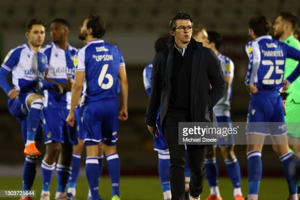 Joey Barton the new manager of Bristol Rovers makes his way to the team bench ahead of the Sky Bet League One match between Bristol Rovers and Wigan...