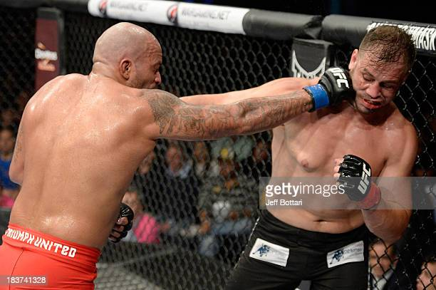 Joey Beltran punches Fabio Maldonado in their light heavyweight bout during the UFC Fight Night event at the Ginasio Jose Correa on October 9, 2013...