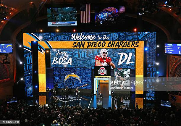 Joey Bosa holds his San Diego Chargers jersey during the 2016 NFL Draft at the Auditorium Theater on April 28 2016 in Chicago Illinois