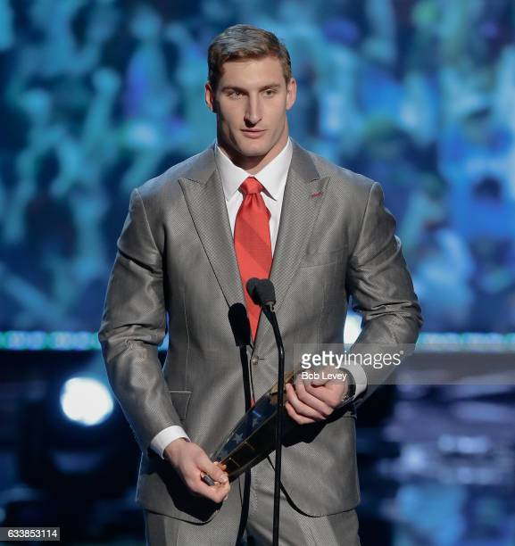 Joey Bosa of the Los Angeles Chargers accepts the AP Defensive Rookie of the Year award at the NFL Honors at the Wortham Theater Center on February 4...