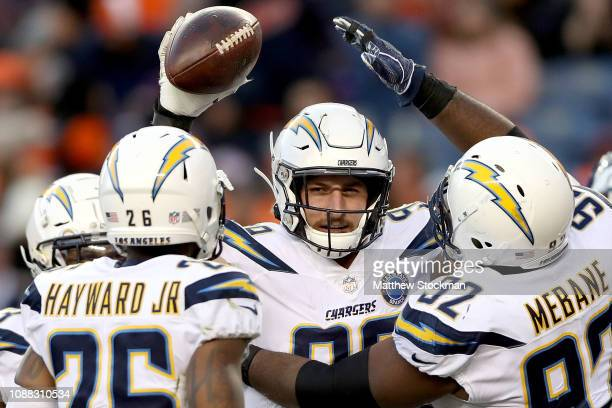 Joey Bosa of the Los Angeles Chargers celebrates a fumble recovery against the Denver Broncos at Broncos Stadium at Mile High on December 30 2018 in...