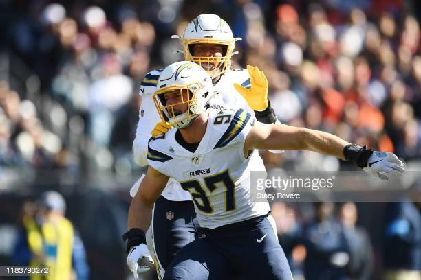 Joey Bosa of the Los Angeles Chargers celebrates after sacking Mitchell Trubisky of the Chicago Bears during the first quarter of a game at Soldier...