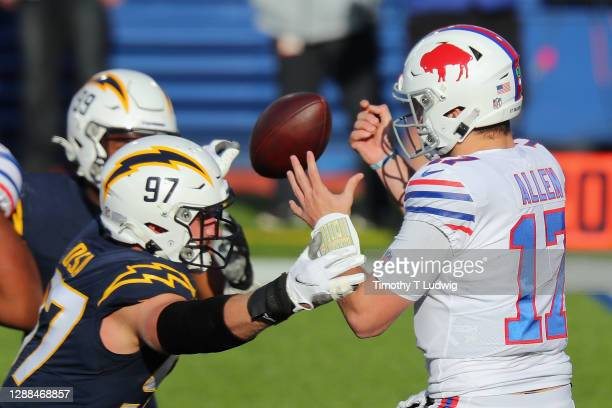 Joey Bosa of the Los Angeles Chargers defends against Josh Allen of the Buffalo Bills during the second quarter at Bills Stadium on November 29, 2020...