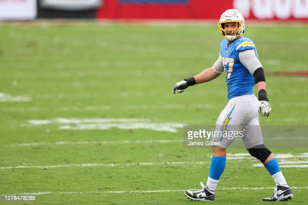 Joey Bosa of the Los Angeles Chargers looks on during the fourth quarter of a game against the Tampa Bay Buccaneers at Raymond James Stadium on...