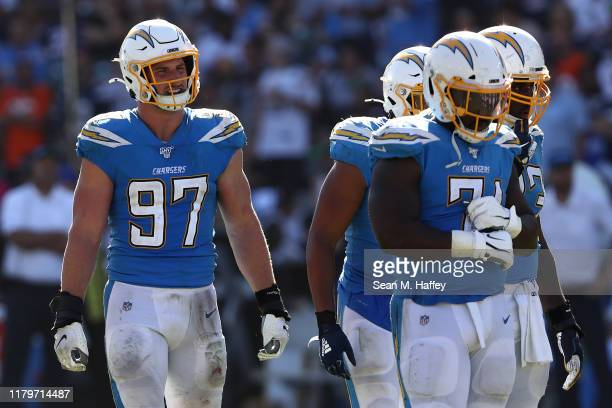 Joey Bosa of the Los Angeles Chargers looks on during the second half of a game against the Denver Broncos at Dignity Health Sports Park on October...