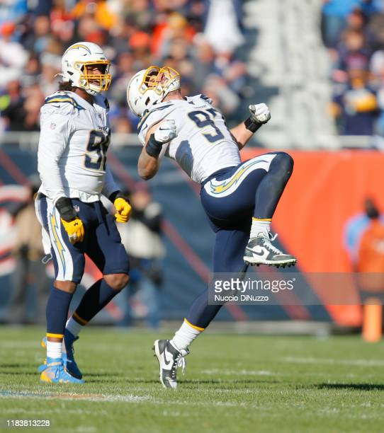 Joey Bosa of the Los Angeles Chargers reacts after sacking Mitchell Trubisky of the Chicago Bears late in the fourth quarter at Soldier Field on...