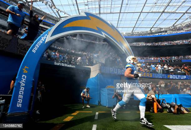Joey Bosa of the Los Angeles Chargers runs on to the field before the game against the Cleveland Browns at SoFi Stadium on October 10, 2021 in...