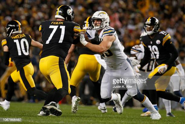 Joey Bosa of the Los Angeles Chargers rushes the pocket against Matt Feiler of the Pittsburgh Steelers in the first half during the game at Heinz...