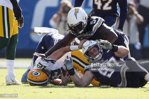Joey Bosa of the Los Angeles Chargers sacks Aaron Rodgers of the Green Bay Packers during the first half at Dignity Health Sports Park on November 03...