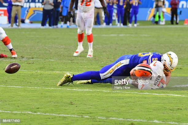 Joey Bosa of the Los Angeles Chargers sacks DeShone Kizer of the Cleveland Browns causing a fumble during the fourth quarter of the game at StubHub...