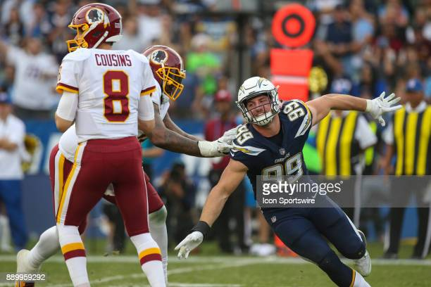 Joey Bosa of the Los Angeles Chargers tries to get Kirk Cousins of the Washington Redskins during a NFL game between the Washington Redskins and the...