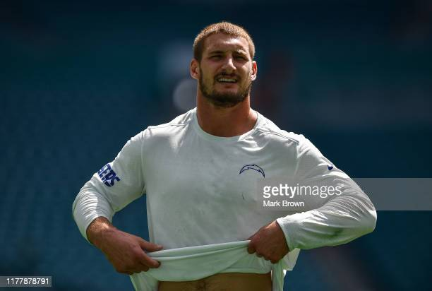 Joey Bosa of the Los Angeles Chargers warms up prior to the game between the Miami Dolphins and the Los Angeles Chargers at Hard Rock Stadium on...