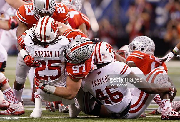 Joey Bosa of the Ohio State Buckeyes tackles Melvin Gordon of the Wisconsin Badgers in the first half of the Big Ten Championship at Lucas Oil...