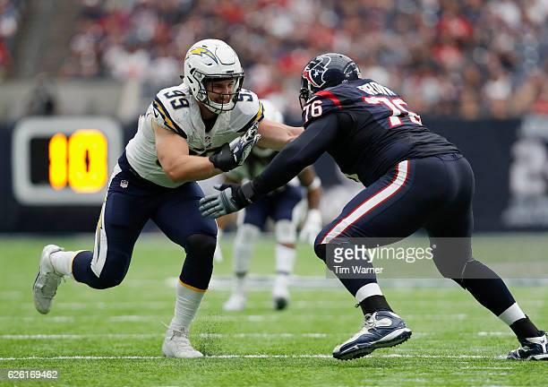 Joey Bosa of the San Diego Chargers battles Duane Brown of the Houston Texans in the fourth quarter at NRG Stadium on November 27, 2016 in Houston,...