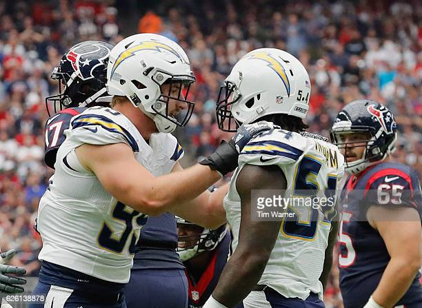 Joey Bosa of the San Diego Chargers celebrates with Melvin Ingram after a sack against the Houston Texans at NRG Stadium on November 27 2016 in...