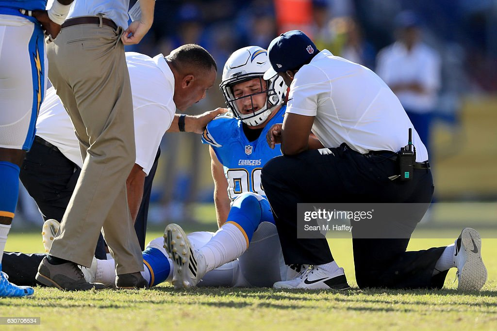 Joey Bosa #99 of the San Diego Chargers recieves medical help after being injured during the second half of a game against the Tennessee Titans at Qualcomm Stadium on November 6, 2016 in San Diego, California.