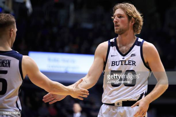 Joey Brunk of the Butler Bulldogs celebrates with Paul Jorgensen of the Butler Bulldogs in the game against the Brown Bears in the second half at...