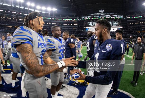 Joey Bryant of the Memphis Tigers and KJ Hamler of the Penn State Nittany Lions after the Goodyear Cotton Bowl Classic at ATT Stadium on December 28...