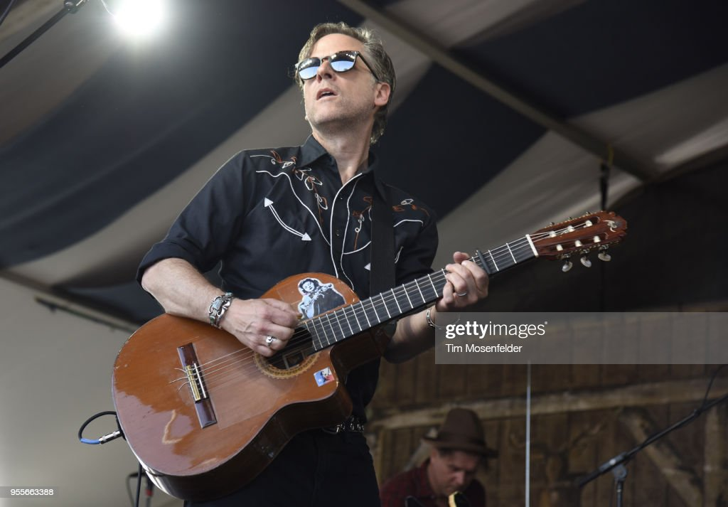Joey Burns of Calexico performs during the 2018 New Orleans Jazz & Heritage Festival at Fair Grounds Race Course on May 6, 2018 in New Orleans, Louisiana.
