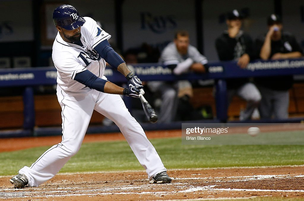 Joey Butler #9 of the Tampa Bay Rays hits a single to second during the fifth inning of a game against the Chicago White Sox on June 12, 2015 at Tropicana Field in St. Petersburg, Florida.