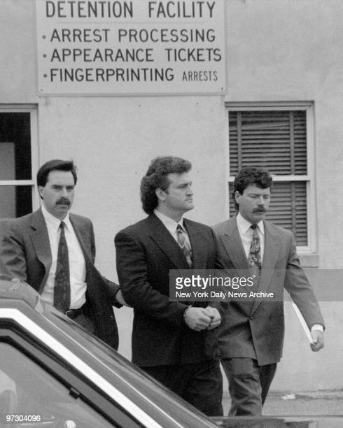 Joey Buttafuoco in handcuffs is escorted to car by Nassau County Police for trip to court