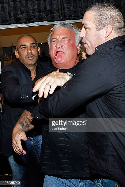 Joey Buttafuoco is held by security after fighting with Amy Fisher's husband Lou Ballera during the Celebrity Fight Night Official Press Conference...
