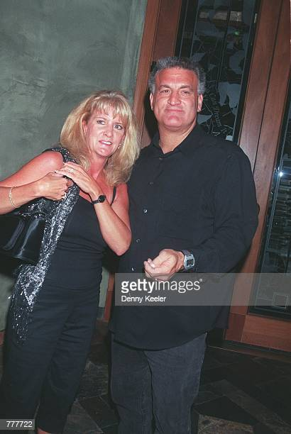 Joey Buttafuoco poses with his wife Mary Jo for the photographer outside Spago restaurant August 22 2000 in Beverly Hills CA