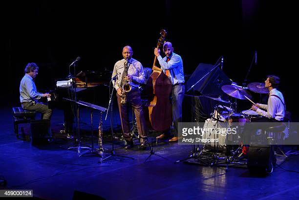 Joey Calderazzo Branford Marsalis Eric Revis and Evan Sherman of the Branford Marsalis Quartet perform on stage during London Jazz Festival 2014 at...