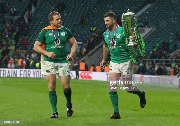 Joey Carbery of Ireland celebrates with The NatWest Six Nations trophy after the NatWest Six Nations match between England and Ireland at Twickenham...