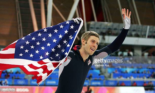 Joey Cheek of USA celebrates winning gold in the skating in the men's 500m speed skating final during Day 3 of the Turin 2006 Winter Olympic Games on...