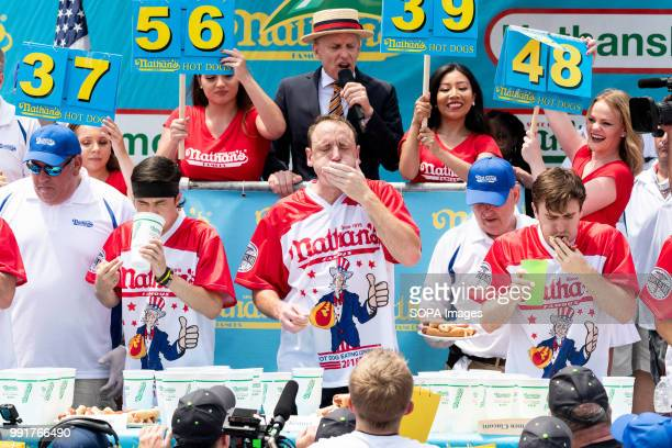 Joey Chestniut ate 74 hot dogs and buns in ten minutes a new world record to win the 2018 Nathans Famous International Hot Dog Eating Contest in...