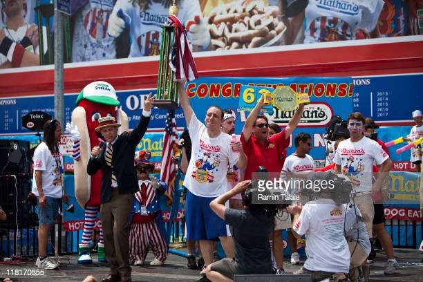 Joey Chestnut celebrates his victory after the 2011 Nathan's Famous Fourth of July International Hot Dog Eating Contest in Coney Island on July 4,...