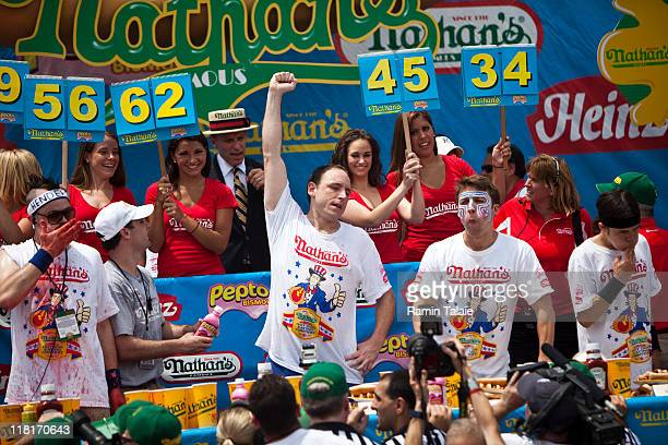 Joey Chestnut celebrates winning at the end of the 2011 Nathan's Famous Fourth of July International Hot Dog Eating Contest at the original Nathan's...