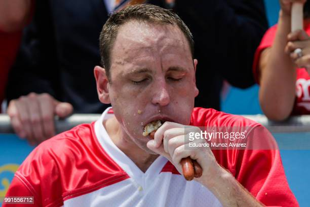Joey Chestnut competes in the annual Nathan's Hot Dog Eating Contest on July 4 2018 in the Coney Island neighborhood of the Brooklyn borough of New...