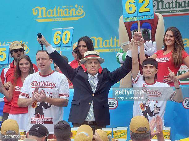 Joey Chestnut George Shea and Matt Stonie attend 2015 Nathan's Famous 4th of July International Hot Dog Eating Contest at Coney Island on July 4 2015...