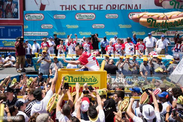 Joey Chestnut is carried to the stage before competing in the 2017 Nathan's Famous International Hot Dog Eating Contest at Coney Island on July 4...