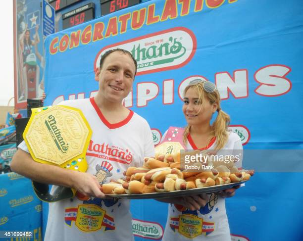 Joey Chestnut wins the Men's Division with 61 Hot Dogs and Miki Sudo wins the Women's Division with 34 Hot Dogs at the 2014 Nathan's Famous 4th July...
