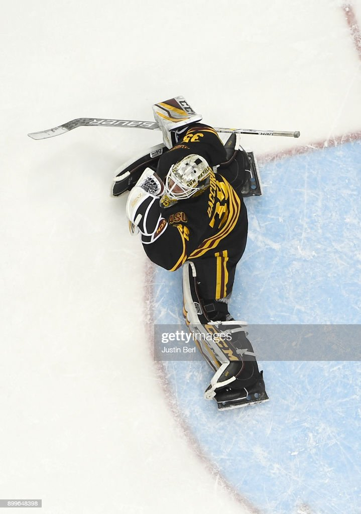 Joey Daccord #35 of the Arizona State Sun Devils makes a save during the game against the Providence Friars at PPG PAINTS Arena on December 29, 2017 in Pittsburgh, Pennsylvania.